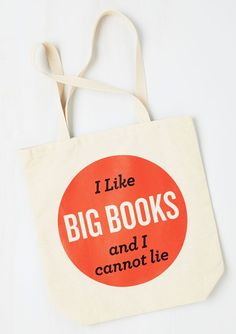 """In bold hues of cherry-red and black, this neutral canvas bag proudly flaunts your astutely charming truth – when it comes to books, you like 'em ""bound"" and big!"""