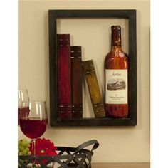 Elegant metal wall hanging looks like a nook in your wall.  The wine bottle and books add a bit of classic charm to your decor.  The metal details seem to float against an open back.