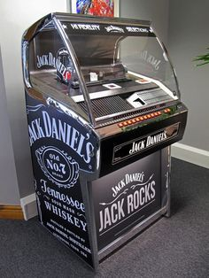 The Jack Daniels Rocket 88 CD jukebox takes its name from the 1951 song by Jackie Brenston and the Delta Cats, hailed as the first true rock 'n' roll record. Jack Daniels Decor, Jack Daniels Bottle, Jack Daniels Whiskey, Jack Daniels Cocktails, Jack Daniel's Tennessee Whiskey, Jack Black, Champagne, American Interior, Jukebox