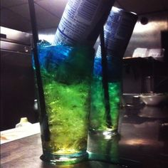 Irish Trashcan  1/2 oz gin  1/2 oz light rum  1/2 oz vodka  1/2 oz peach schnapps  1/2 oz Blue Curacao liquor  1/2 oz triple sec  1 can Red Bull energy drink  Fill glass with ice, then add all liquors and stir. Add full can of Red Bull. The can will float and slowly seep down the glass, turning the mix green, hence the name Irish Trashcan.
