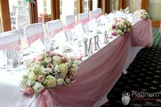 3 flower arrangements for top table with swagging in your colour
