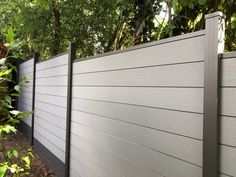 SAiGE Composite Fencing in grey and charcoal Backyard Bar, Backyard Fences, Backyard Landscaping, Privacy Fence Panels, Privacy Fence Designs, Modern Wood Fence, Screened In Patio, Deck Patio, Composite Fencing