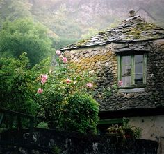 Stone cottage with roses