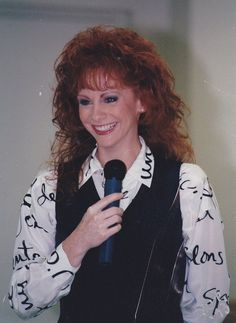 I've been listening to the new songs from my pre-order of this fabulous woman's new CD all day. #obsessed #Reba