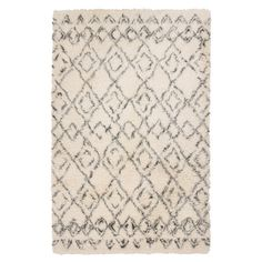 Anchor your living room seating group or define space in the den with this handcrafted New Zealand wool rug, showcasing a diamond-inspired trellis motif for ...