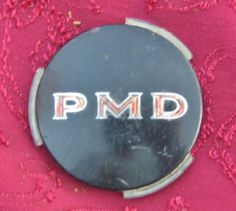 old Pontiac emblem# #Vintage Pontiac Black PMD 2 7/16 Wheel Cover Hub Cap Emblem Insert OEM #Pontiac this is now for sale on ebay for 99 cents search ebay for item number 351254885316