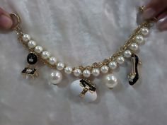 Ebony and Ivory Bracelet - beautiful pearly bracelet with unique charms.