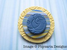 Brooch made from polymer clay tiles.