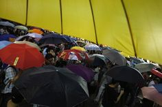 HONGKONG-CHINA/ Pro-democracy protesters hold up umbrellas, symbols of Occupy civil disobedience movement, as they mark exactly one month since they took the streets in Mongkok shopping district in Hong Kong October 28, 2014. Hong Kong has been roiled by a tenacious, month-long student-led people's movement demanding full democracy in the former British colony that returned to Chinese rule in 1997. REUTERS/Bobby Yip