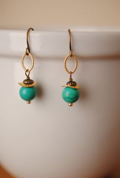 Simple handmade gemstone earrings for women features a turquoise focal