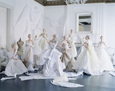 Tim Walker - Eight models in paper dresses after Cecil Beaton's image of debutantes in Charles James