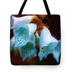 "pick your poison foxgloves in blue Tote Bag by Anna Porter (18"" x 18"").  The tote bag is machine washable, available in three different sizes, and includes a black strap for easy carrying on your shoulder.  All totes are available for worldwide shipping and include a money-back guarantee."