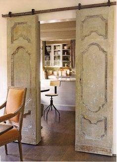 Hmmmm.....maybe replace French doors to my office with these????    Reclaimed antique doors on sliding mechanism