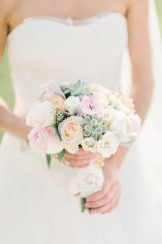 Succulent + rose wedding bouquet: http://www.stylemepretty.com/virginia-weddings/purcellville/2016/01/12/rustic-chic-pastel-shadow-creek-wedding-in-virginia/ | Photography: Elizabeth Fogarty - http://elizabethfogartyphotography.com/
