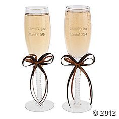 """Personalized Champagne Flutes With Brown Bows    IN-47/558    Personalized Champagne Flutes With Brown Bows. A nice gift for a wedding or anniversary party! Just perfect for a toast, these elegant glasses feature a brown bow. Personalize with 2 lines of 20 characters/spaces per line. (2 pcs. per set) 10 3/4"""" 7 oz."""