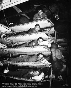 Shipboard life, WWII: GIs in bunks on the U. Army transport SS Pennant on November It paid to be on the top bunk due to soldiers getting seasick! Us Marines, World History, World War Ii, Ww2 History, Interesting History, Japan, Military History, Military Photos, Old Photos