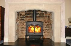 Renovated original inglenook chamber with bespoke hand carved English limestone mantel, natural slate tiled hearth and wood stove fitted in ...