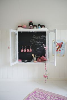 Paint the back of a cabinet with chalkboard paint