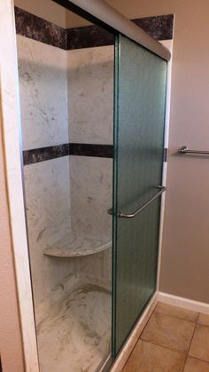 Cultured Marble Tub to Shower Conversion  Burnt Almond Wall Panels with Abalone Travertine Trim, 3/8's Heavy Rain Glass Brushed Nickel Trim