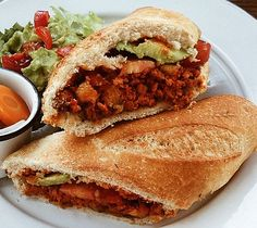 Al pastor-style vegan pork torta sandwich, with beans, avocado, pickled peppers, and chilies, from the all-veg restaurant Cate de mi Corazon in Mexico City!