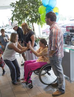Courtney celebrated with friends and family before receiving the second #wheelchair accessible vehicle in the Local Heroes contest. #NMEDA #NMAM14