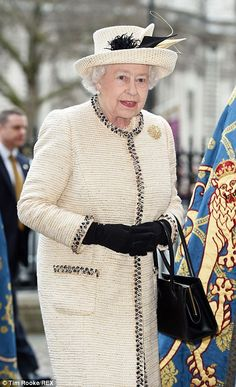 Elegant: The Queen looked wonderful in an ivory wool-tweed coat, a matching hat and carrie...