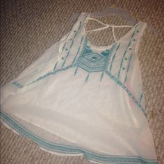 Cross cut back flowy boho turquoise tank Super cute and a little sheer. Looks great over swimsuits and with any bottoms!! Has gorgeous detailing and in perfect condition Xhilaration Tops Tank Tops