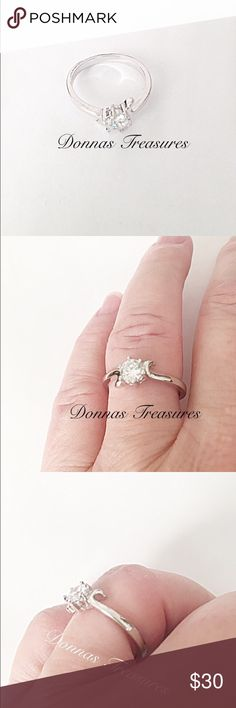 🎄1/2 Carat AAA CZ Engagement/Promise Ring This simple ring is an approx 1/2 Carat AAA CZ in a 14K White Gold Filled setting. On each side is a slight downward swirl to give it a little extra style. #0837-1 Jewelry Rings