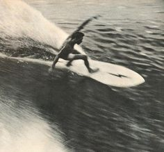 Gerry Lopez and his lighting bolt surfboard