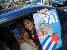"""Castro won,A woman with a poster of the Cuban Five, which reads """"Freedom Now"""" in Spanish, celebrates their release in Havana, Cuba, on Wednesday, Dec. 17, 2014. (AP Photo/Ramon Espinosa)<br />"""