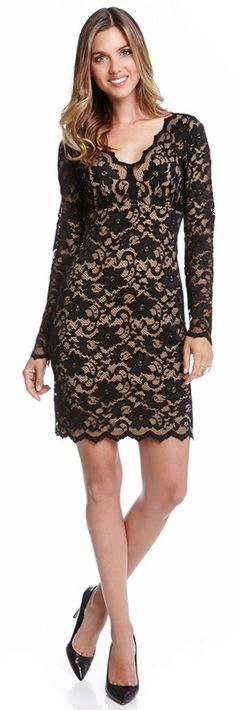 Beguiling black lace brings showstopping romance to a V-neck dress in a flattering Empire-waist design with sheer long sleeves and scalloped edges.