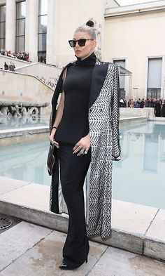 The 'Dutchess' touched down in Paris. Fergie wore a black dress with a patterned coat to the Rick Owens show. Photo: WireImage
