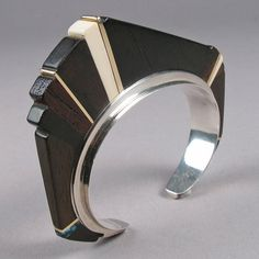 Cuff | Charles Loloma (Hopi Pueblo). Sterling silver, ironwood, 14k gold, fossilized ivory and turquoise. ca. 1970s