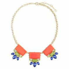 """Add a pop of style to evening ensembles and work outfits alike with this stunning gold-plated necklace, showcasing faceted orange beads highlighted by shimmering gem stone-inspired teardrops.     Product: NecklaceConstruction Material: Zinc alloy, resin and rhinestonesColor: Orange, blue, green and gold Features:  Adjustable chain length adds up to 1.5""""  Handmade   Dimensions: Chain: 20""""Stones: 1.5"""" H x 4"""" WCleaning and Care: Avoid all oils and chemicals (such as lotions, hairspray, makeup…"""