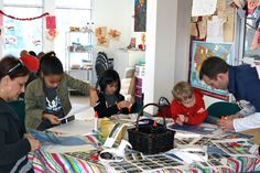 """families making """"Bridging Our Future"""" placemats"""