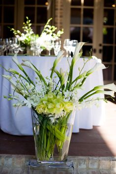 Green and White Centerpieces  http://significanteventsoftexas.com/