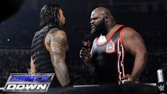 Roman Reigns spears a returning Mark Henry through the barricade: SmackDown, March 12, 2015