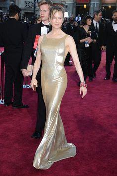 Renée Zellweger: Renée Zellweger channeled the Oscar statuettes in a gilded Carolina Herrera gown.