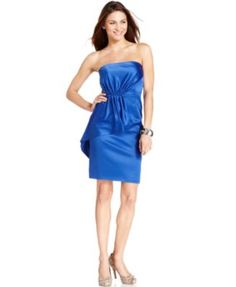 Vince Camuto\'s dress is sophisticated, strapless and decked out with a peplum-inspired tier at one hip.