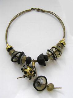 Necklace | Anat Sapir. Glass, etched glass, 22 karat gold leaf, golden leather cords.