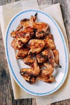 Three-Ingredient Grilled Chicken Wings | The Woks of Life Chicken Stuffed Peppers, Stuffed Whole Chicken, Honey Sriracha Chicken Wings, Asian Chicken, Grilled Chicken Wings, Salt And Pepper Chicken, Dinner Dishes, Main Dishes, Dinner Recipes