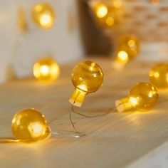 50 Amber Bauble Micro Fairy Lights | Lights4fun.co.uk White Led Lights, String Lights, Pile Aa, Ambre, Fairy Lights, Decoration, Light Bulb, Glow, Display