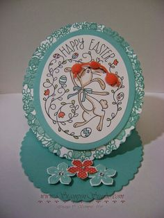 "Stampin' Up! ... hand crafted Easter card from Stampin' Studio ... oval easel format ... trio of popped up flowers forms the ""stop"" ... dancing bunny and flourishes ..."