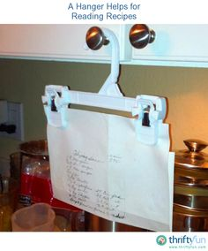 GENIOUS! A hanger on the cabinet for reading recipes.