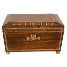 An early century Regency period rosewood brass inlaid tea caddy of sarcophagus form, raised on ball feet; opening to a fitted brass inlaid and mirrored interior. CIRCA: 1810 DIMENSIONS: h x w x d Wooden Jewelry Boxes, Wooden Boxes, Decorative Objects, Decorative Boxes, Painted Trunk, Tea Canisters, Victorian Furniture, Antique Boxes, Tea Caddy