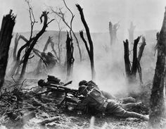 An American machine gun crew firing during an advance against entrenched Germans during the Meuse-Argonne Offensive. 1918.