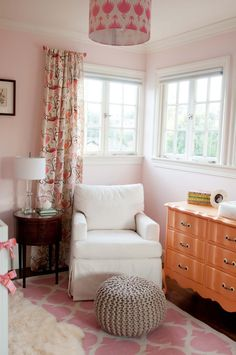 I love that this is a pink nursery for a girl... but it isn't overwhelming or harsh like some of those pepto pink walls