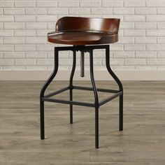 Distressed for a well-loved look, this stool offers relaxed style and an easy option to pull up to your countertop. Metal detailing creates a slight backrest and the seat is shaped for your comfort.