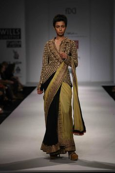 PHOTO CREDIT: WIFW Spring/Summer 2013 Anand Kabra's Spring/Summer 2013 collection has been inspired by the story of a dancer, Taramati. Really liked how the designer has created some very interesting shapes both in terms of the prints and the silhouettes.
