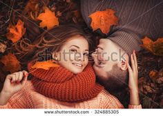 Young couple in love outdoor.Stunning sensual outdoor portrait of young stylish fashion couple posing in park in autumn - stock photo
